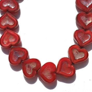 Six Czech glass heart beads; 14 x 12mm table cut, carved, opaque marbled red hearts with a silver picasso finish C6906
