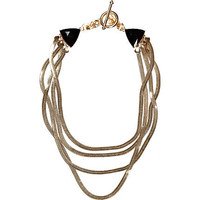 Gold tone slinky layered necklace