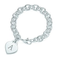 Tiffany & Co. -  Alphabet heart tag bracelet in sterling silver, medium. Letters A-Z available.