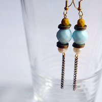 Bead and metal tassel earring. Milky blue rondelle, fresh water pearl, yellow bead, nuts & bolts. Antique copper findings, gold earring hook