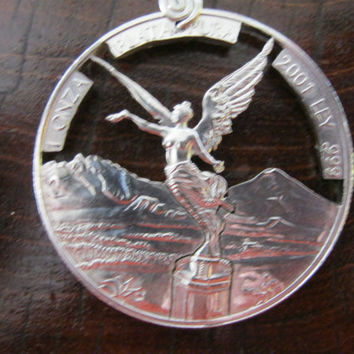 1 Oz. SILVER Angel Hand Cut Coin por InterlockingQuarters en Etsy