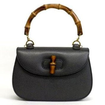 MINT. Vintage Gucci genuine black pigskin leather handbag purse with bamboo handle. Classic purse from Bamboo collection.