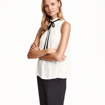 H&M Sleeveless Tie Blouse $29.99