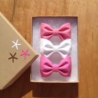 Bright pink, pink polka dot and white hair bows from Seaside Sparrow. Perfect gift for her.