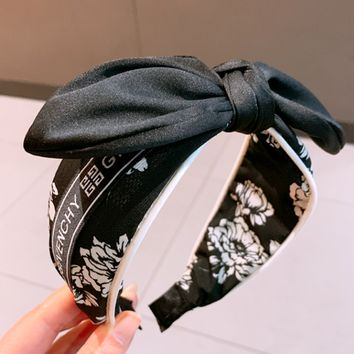 Givenchy 2019 female personality wild flower print wide-brimmed bow headband hairpin black