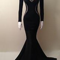 Embroider mermaid gown with zipper on back.Materials: 98% Polyester, 2% Elastane