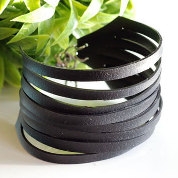 Upcycled bike inner tube black bracelet , recycled bicycle tire lines cuff bracelet in an adjustable size with a leather like feel and look