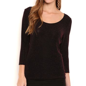knit metallic top with three quarter sleeves and open bar back