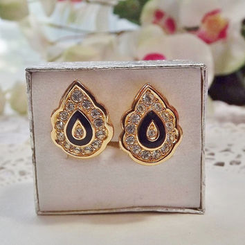 Signed Christian Dior Black and Gold Clip-On Earrings with Diamond-Cut Crystals.