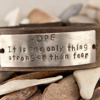 Leather hunger games cuff, Hope it is the only thing stronger than fear,  leather bracelet