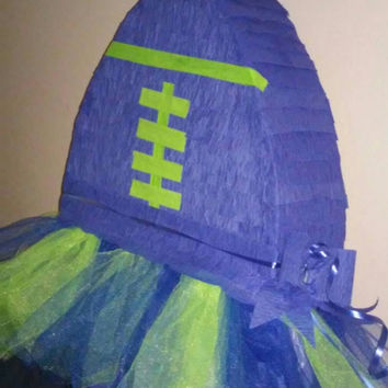 Football pinata inspired by Seahawks colors for birthday, gender reveal, baby or bridal shower.