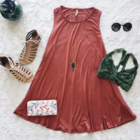 A Sleveless Swing Dress in Brick