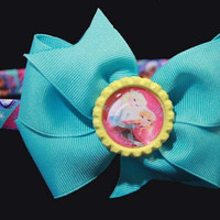 Elsa and Anna  are the main features in this Light Blue bow ,headband is 1/2 inch(15mm) wrapped in a grosgrain ribbon  Frozen characters