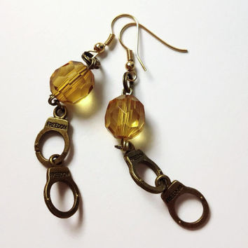 Bronze handcuff charm dangle earrings with yellow beads