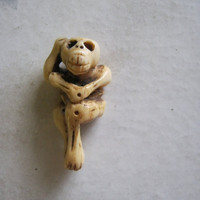Monkey Skeleton Bone Bead, hanging