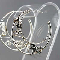 Seahorse and starfish hoop earrings, sterling silver. Artisan handmade jewelry.