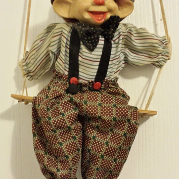 Vintage clown puppet marionette #3 (large) with adorable porcelain painted face.  Seated on a wooden swing.  #cuteclown #marionette