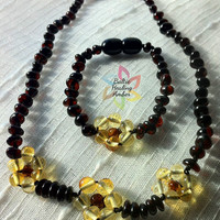 Matching Baby Baltic Amber necklace and bracelet with flower, designed with 100% Baltic amber dark cherry and lemon polished beads.