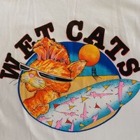 WET CATS on a white tee shirt..