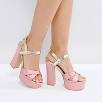 Public Desire Vamp Pink and Gold Platform Heeled Sandals at asos.com