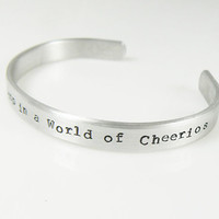 hand stamped bracelet Be a Fruit Loop in a World of Cheerios typewriter font