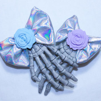 skeleton hand iridescent bow rose hair clip