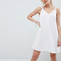 ASOS DESIGN Petite knot strap mini swing dress at asos.com