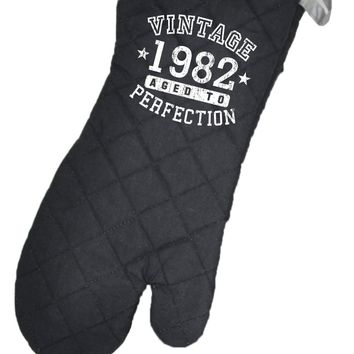 Personalized Vintage Birth Year Black Fabric Oven Mitt by TooLoud