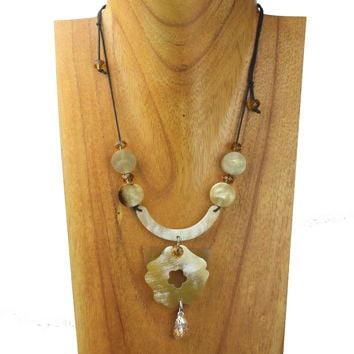 Horn necklace with backing stone charm. NS-106