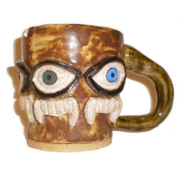 Eye Cup (32) - Handbuilt coffee mug with pattern of molded eyes and fangs