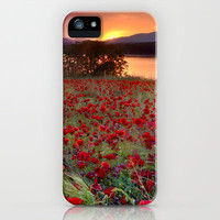 Sea of poppies at the lake iPhone Case by Guido Montañés