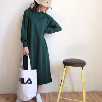 A solid colour hooded dress in autumn