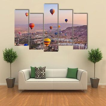 Hot Air Balloon Flying Over Rock Landscape Multi Panel Canvas Wall Art