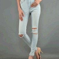 Get the look right every time in this cozy Fallen Love High Waisted Jeans. These light wash jeans features distressed cutout design at front, stretchy taper cut, high waisted design, five pockets, belt loops, zipper fly, and single button closure.