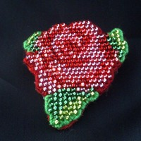 Red rose beaded brooch.