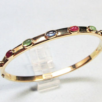 Cabochon Ruby Emerald and Sapphire Precious Stone and 14 Karat Yellow Gold Bangle