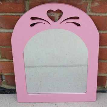 Pink chalk paint decorative wall mirror with heart cutout