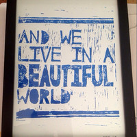 And we live in a beautiful world BLUE letterpress poster 8x10 - LINOCUT PRINT