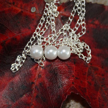 Three Pearl necklace, with a sterling silver plated chain
