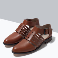 Flat leather cut-out shoes