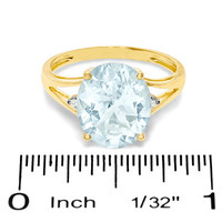 Oval Aquamarine Split Shank Ring in 14K Gold with Diamond Accents