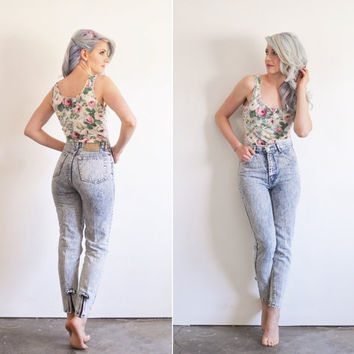 high waist acid washed BOW jeans . zip up ankle and everything .extra small.xs