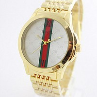 Gucci Fashion Men Women Casual Quartz Watch Exquisite Creative Striped Mirror Wrist Watch Gold Belt White Dial
