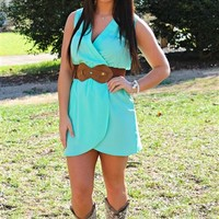 Mint wrap like dress with a plunging neckline.
