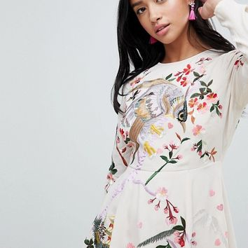 ASOS DESIGN Petite Mini Dress With Pretty Floral And Bird Embroidery at asos.com