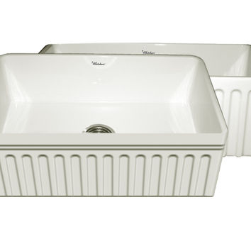 Quatro Alcove reversible fireclay sink with a fluted front apron and a decorative 2 ½ inch lip on one side and a fluted front apron on the opposite side