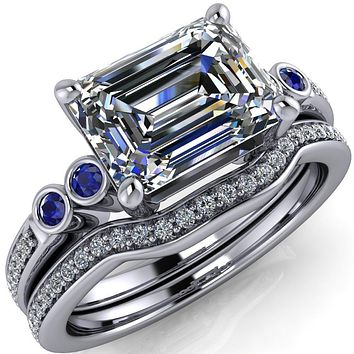 Philippa Emerald Moissanite 4 Blue Sapphire Sides 4 Prong Under Bezel Multi Stone Engagement Ring