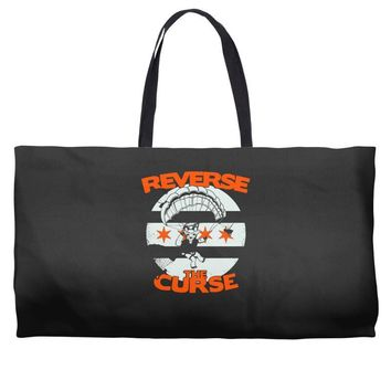 reverse the curse Weekender Totes