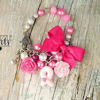 breast cancer awareness pink ribbon bracelet in hot pink and light pink