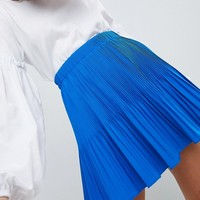 ASOS DESIGN Petite pleated mini skirt at asos.com